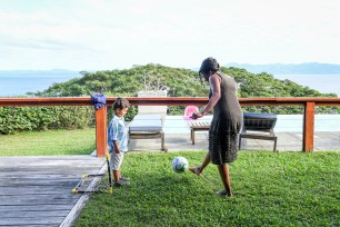 Polynesian mom plays soccer with son during Fiji family vacation