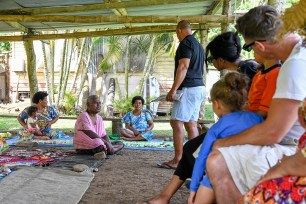 Mixed race family in Fiji traditional meeting