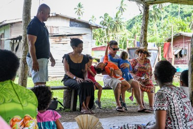 Family seated at traditional Fiji gathering during family vacation