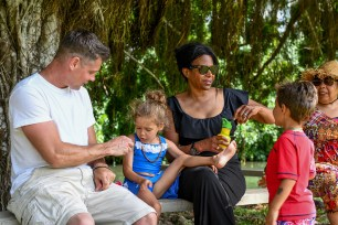 Fiji family sit on bench during family vacation