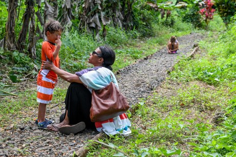 Mom soothes crying son in Fiji
