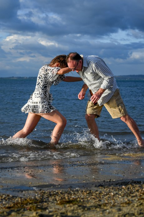 Fahter and daughter wrestle on the waters of Denarau Fiji