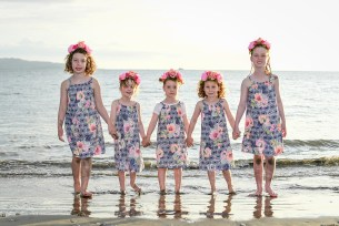 Cousins in matching outfits and flower crown walk on the Natadola beach at Denarau Fiji