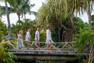Family walking on the bridge at the Outrigger during the photoshoot