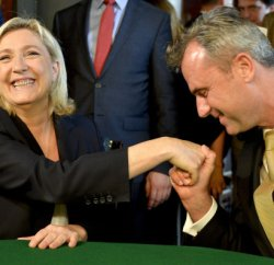 "Former presidential candidate of the  Austrian far right party FPOe Norbert Hofer (R) welcomes President of French far-right party Front National Marine Le Pen (L) prior to their meeting of the EU's far-right Europe for Nations and Freedom bloc, named ""Patriotic Spring - cooperation for friendship, safety and prosperity"" on June 17, 2016, in Vienna, Austria. / AFP PHOTO / APA / HERBERT NEUBAUER / Austria OUT"
