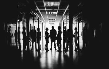 Employees talking in corridor of business center