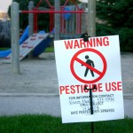 """Pesticide Use"" sign at playground"