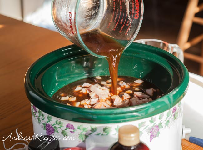 Andrea Meyers - Pour the molasses mixture over the beans. (Slow Cooker Boston Baked Beans)