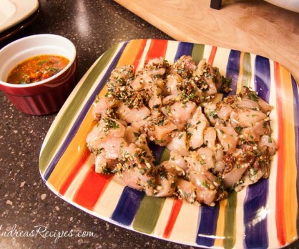 Chicken marinating in the pesto