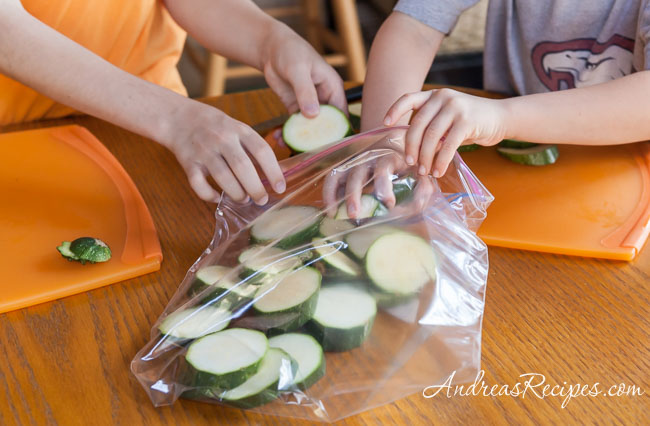 Andrea Meyers - Bagging sliced zucchini.