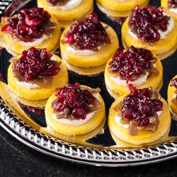 Polenta Toasts Recipe with Goat Cheese, Caramelized Onions, and Port Cranberries - Andrea Meyers