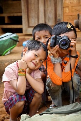 portrait of children discovering photography (Myanmar, 2011)