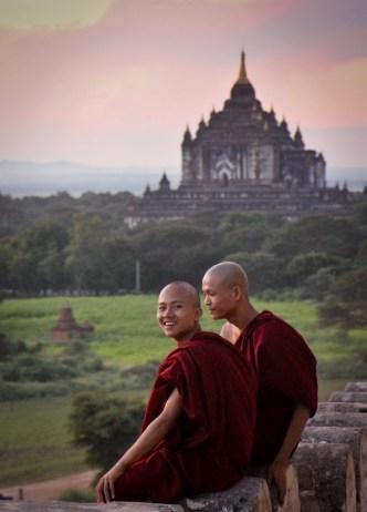 young Buddhist monks enjoying sunset in Bagan, Myanmar