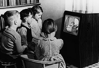 MONOCHROME BOX_Children watching Andy Pandy on a black and white TV.