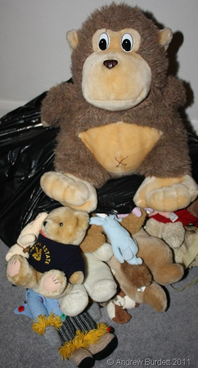 BURSTING AT ITS SEAMS_Mr Monkey guards the bag of stuffed toys.