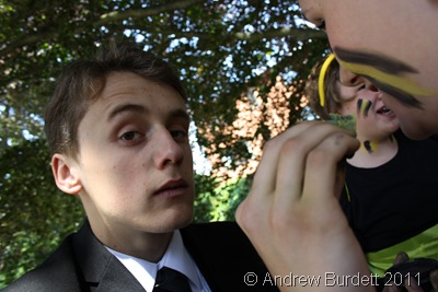 WHY HELLO_Ryan Tomlinson, a Norden Lights Acadamy member, helps apply a child's bee face-paint.