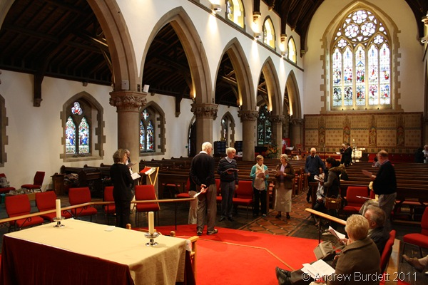 TAKE YOUR PLACES_Preparing for the service, the members of the clergy and churchwardens assist with the rehearsal.
