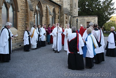 GET READY_Clergy, the choir, and servers ready to enter in procession.