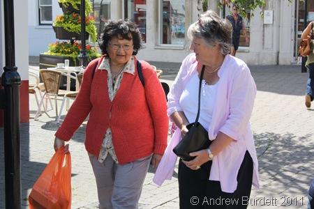 KEEP ON WALKING_Despite sore toes, Fran Hornby wears a smile as she walks through Littlehampton town with a friend.