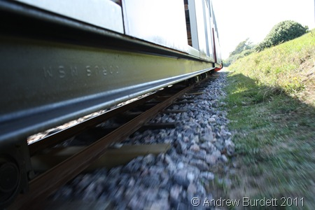 TRAIN TRAVEL_The miniature railway speeding away.