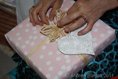 PACKAGES TIED UP WITH STRING_Mum unwraps a beautifully-presented gift.
