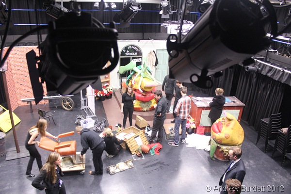 ALL SET TO GO: Stagehands working tirelessly to strike the set and stage. (IMG_2951)