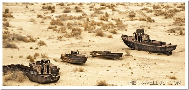 DESERT ISLAND SHIPS: Boats lay wrecked in a sea of sand.