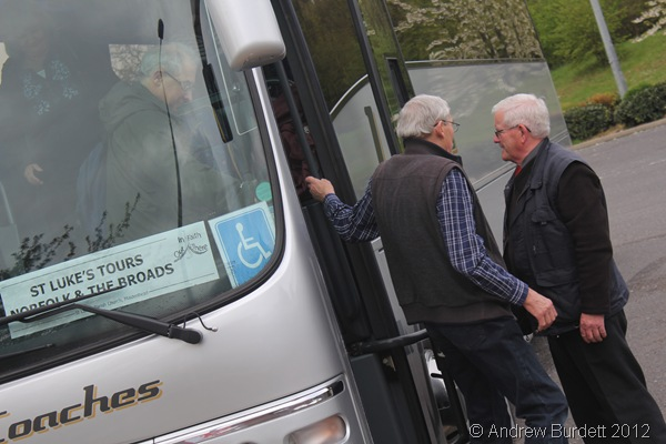WELCOME BREAK: Don Luff and Rhidian Jones are helped off the coach by driver Michael Poynter, as the tour bus arrived at Birchanger Services. (011_IMG_1698_ARB)
