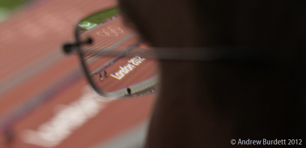 EYES OF THE WORLD: Matthew, my brother, looks down at the track of the London 2012 Olympic Stadium. (IMG_2596)