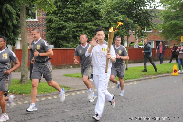 RELAY RUNNER: Torchbearer 132 running with the Flame. (IMG_8567/OXFORD)