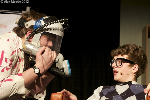 IT'S STUCK: Me, left, as Orin, asking my dental patient, Seymour, for help with removing my laughing gas mask. (IMG_3718_AlexMeade)