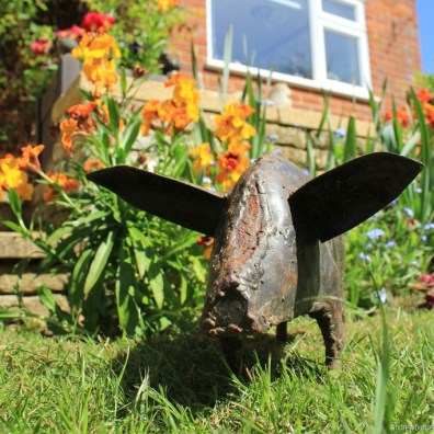 A metal pig garden ornament.
