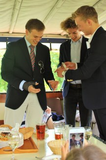 Andrew Burdett, Jack Chapman, and Ali Cawthorpe preparing to do shots.