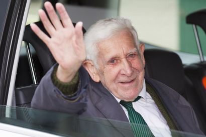 David Jordan, a D-Day veteran, waves on his return from the D-Day 70 commemorations.