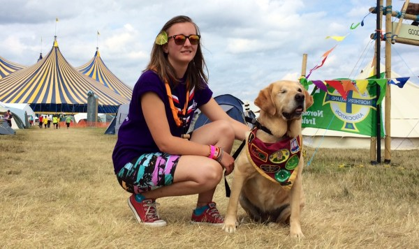 Henri, 16, with hearing dog Odi - who has her own neckerchief.
