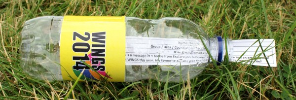 A mock-up WINGS water bottle (made at 6:00pm yesterday afternoon) with a message enclosed, for the Daily Brew newspaper.