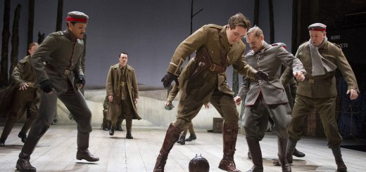 Warring soldiers playing football during a scene in 'The Christmas Truce'.