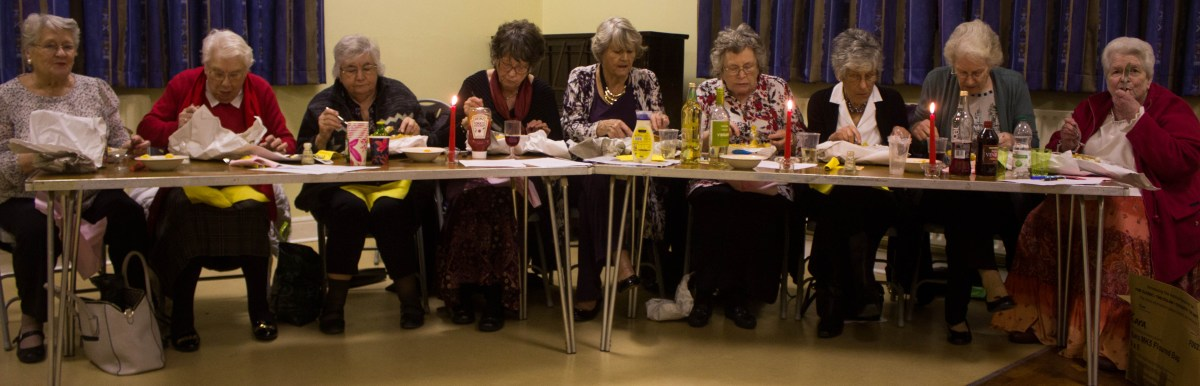 Some of the ladies of St Luke's enjoying their fish-and-chip suppers.