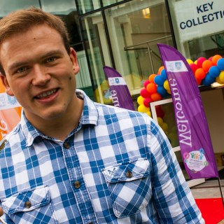 Andrew Burdett with his room key at the Endcliffe Student Village.