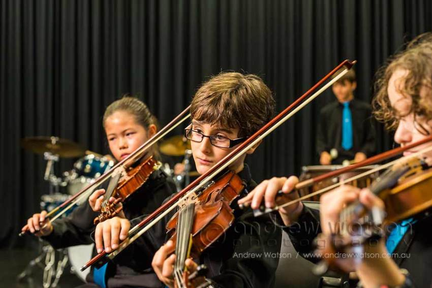 Image of school students playing instruments in string ensemble