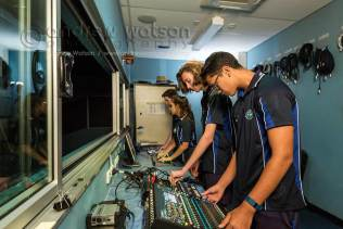 Image of school students at audio and lighting decks