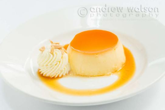 Image of a creme brulee served with cream