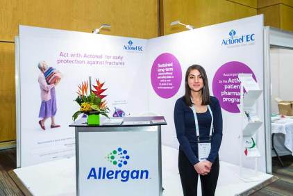 Image of staff in front of trade exhibit booth at ANZSGM 2016
