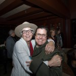 Grace Contro, winning bidder of the Ranger's hat, celebrates with Amy Brees