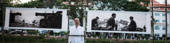 Photographer Zeng Nian by his exhibition along the Siem Reap River © Soumyadip Ghosh