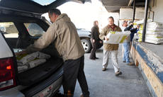 Jill Pickett Bill Nall of Southern States loads a bag of cat food Tuesday into an SUV, as Larry Jaggers II of Hardin County Farm Bureau carries another bag followed by Mark Thomas of Hardin County Cattlemen's Association, Penny Edwards, manager of the Animal Refuge Center in Vine Grove and Jade Sadler of Farm Credit Mid-America at Southern States in Elizabethtown. The food was approximately 500 pounds of a 2,000-pound donation to the shelter. The remaining food will be picked up by the shelter as needed. Buy this photo