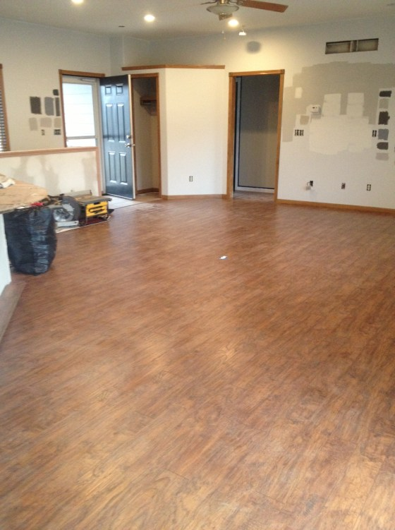 Immediately after Day 1 - the living room floors are installed, but dusty.