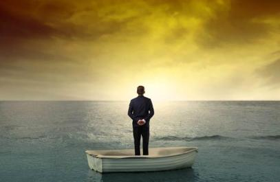 isolated-man-staring-out-to-sea-in-boat