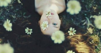 woman-staring-flowers