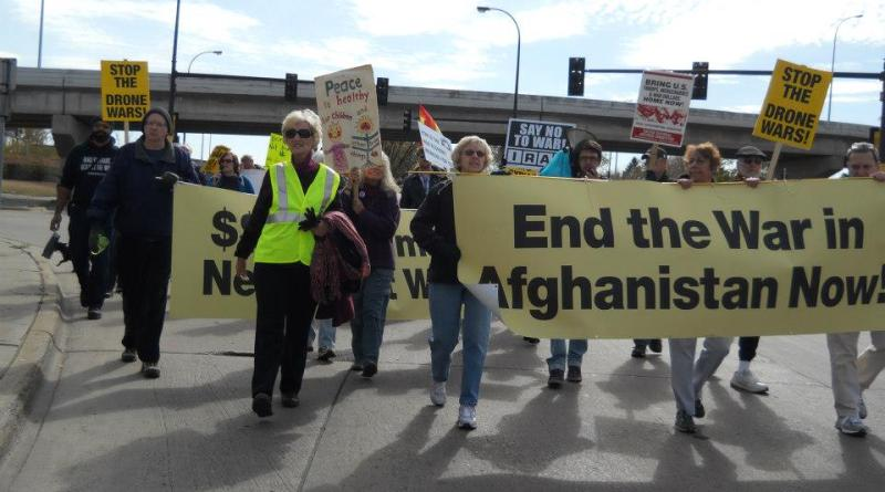 Ray Camper (far left) marches with other protesters in Minneapolis, MN on the 11th Anniversary of the Afghanistan War. (Photo by Kim DeFranco)